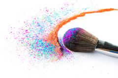 Multi Colored Powder Eyeshadow on a Brush, fashion beauty - stock photo