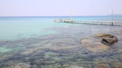 Tropical beach and wooden pier on the sea water. Koh Kood, Thailand Stock Footage