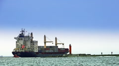 Big containerships along the lighthouse sail Stock Footage