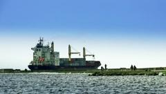 Anonymous people walking containerships Stock Footage