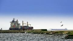 Two large ships and anonymous people who walking by mole Stock Footage
