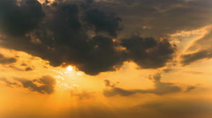 Beautiful cloudy sky with  sun in red and orange tones. 4K 4096x2304 . Time lap Stock Footage