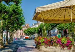 Colourful street scene in Saint-Jean-de-Luz, France. Stock Photos
