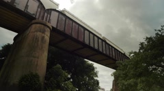 Freight Train Moves Along Elevated Bridge Stock Footage