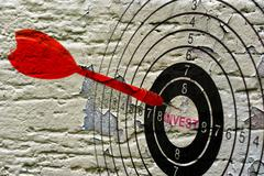 Stock Photo of Invest target on grunge background