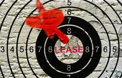 Lease target on grunge background Stock Photos