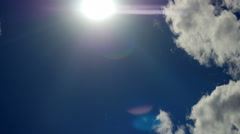 Clouds, time lapse. Anamorphic lens flare. - stock footage
