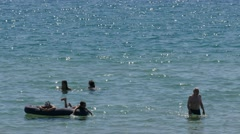 People bathe in the shallow bay. Stock Footage