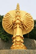 Golden Statue of Guan Yin Stock Photos