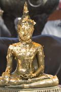 Buddha Image Covered with Gold Leaves - stock photo