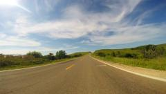 POV Driving through hills and natures blue sky - stock footage