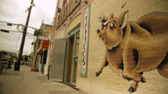 Hog Mural Next to Tattoo Shop Stock Footage
