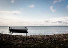 Bench on a Curonian Lagoon shore. Neringa, Lithuania Stock Photos