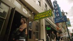 People Walk by Bars Stock Footage