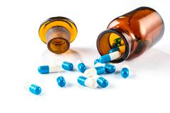 blue capsules with  bottle, healthcare and medicine - stock photo
