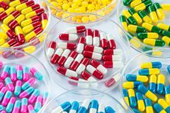 colorful medicament in Petri Dish,  Healthcare And Medicine - stock photo