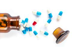 Blue capsules and red capsules with  bottle, healthcare and medicine Stock Photos