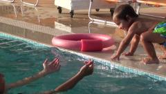 Stock Video Footage of Toddler gets from swimming pool and jumps there again