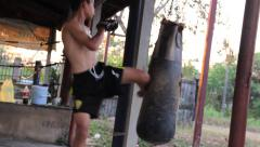 Young Fighter Training Muay Thai Boxing With Heavy Punching Bag Outdoor Gym Stock Footage