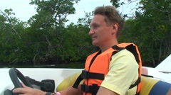 Man drive motor boat in the mangrove jungle Stock Footage