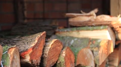 Stacked firewood with hands Stock Footage