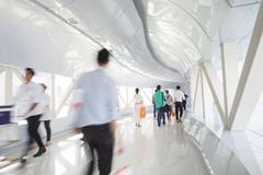 Business people walking in the office corridor. - stock photo