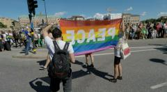 Peace rainbow flag at Gay pride parade in Stockholm SloMo friendly Stock Footage