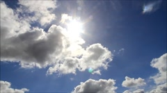Sun shining through clouds in the blue sky Stock Footage
