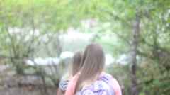 Two girls hike down a path Stock Footage