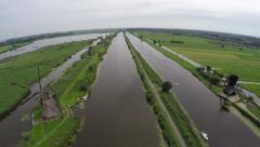 Aerial Kinderdijk Childrens Dike windmills low pass Unesco World Heritage 4k Stock Footage