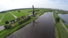 Aerial Kinderdijk Childrens dike operational windmill turning blades 4k Stock Footage