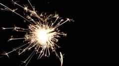 burning sparkler against a black background - stock footage