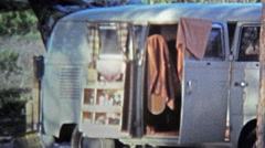 1971: Hippie bus camping on beach with mailbox address. Stock Footage