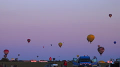Flying hot air Balloons 50 - Time lapse - many balloons in a summer evening sky Stock Footage