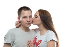 Image of two kissing teenagers - stock photo