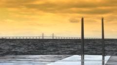 Pier and Ladder on Sea with Bridge Oresund 4 Stock Footage