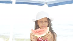 Child eating watermelon at sea Stock Footage