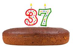 birthday cake with candles number thirty seven - stock photo