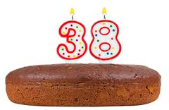 Stock Photo of birthday cake with candles number thirty eight