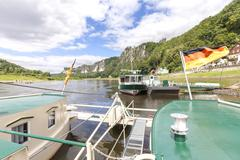 Ferry crossing Elbe river in Rathen, Germany. Stock Photos