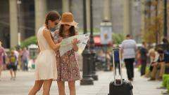 Young Woman with tourist map Asking  passer-by For Direction on a city street. Stock Footage
