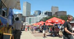 4K People enjoying gourmet and ethnic food trucks with Denver skyline Stock Footage