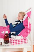 Sick teenager girl with temperature - stock photo