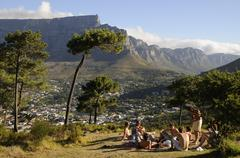 Group of youngsters sitting overlooking Table Mountain and the Twelve Apostle Stock Photos