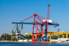 Large cranes on a pier in the seaport of Gdansk - stock photo