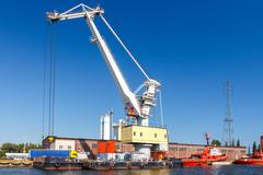 Large cranes on a pier in the seaport of Gdansk. - stock photo