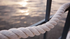 Rope on background of water in the yacht club Stock Footage