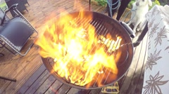 Charcoal lighter fluid, on a warm barbeque Stock Footage
