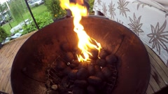 Lighting up black briquettes, in a barbeque - stock footage