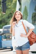Beautiful young girl is ready for her journey - stock photo